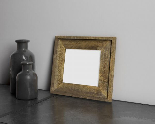 Photoshop Mockup of White House Custom Color Barnwood Frame with Trim on dark table with small, dark pieces of pottery.