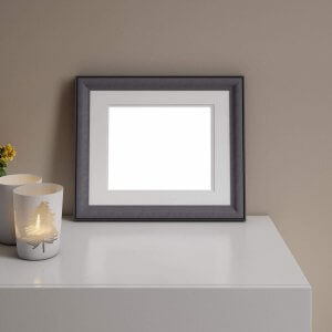 Small matted WHCC Lexington Frame in Iron on a table with candles.