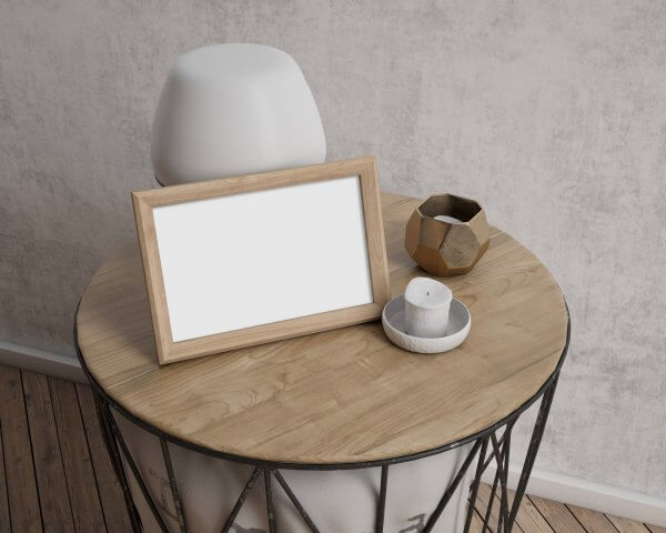 WHCC Reclaimed Walnut Frame mockup on a small table with candles and a lamp